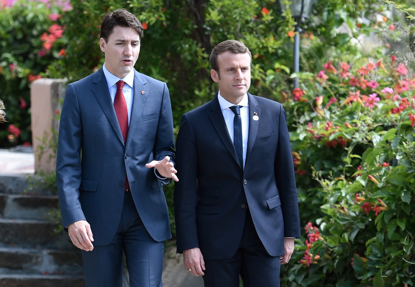Justin Trudeau speaks with Emmanuel Macron